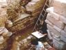 Lavoro degli archeologi presso l'abside della chiesa paleocristiana (presso Revoir)